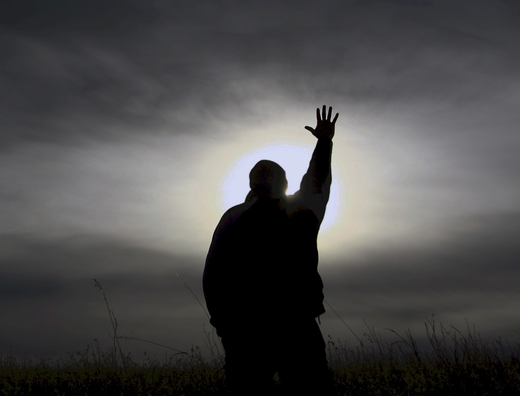 picture of man reaching out to God